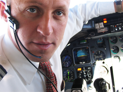 James Berisha behind the controls of a Learjet which he flies for Sierra West Airlines